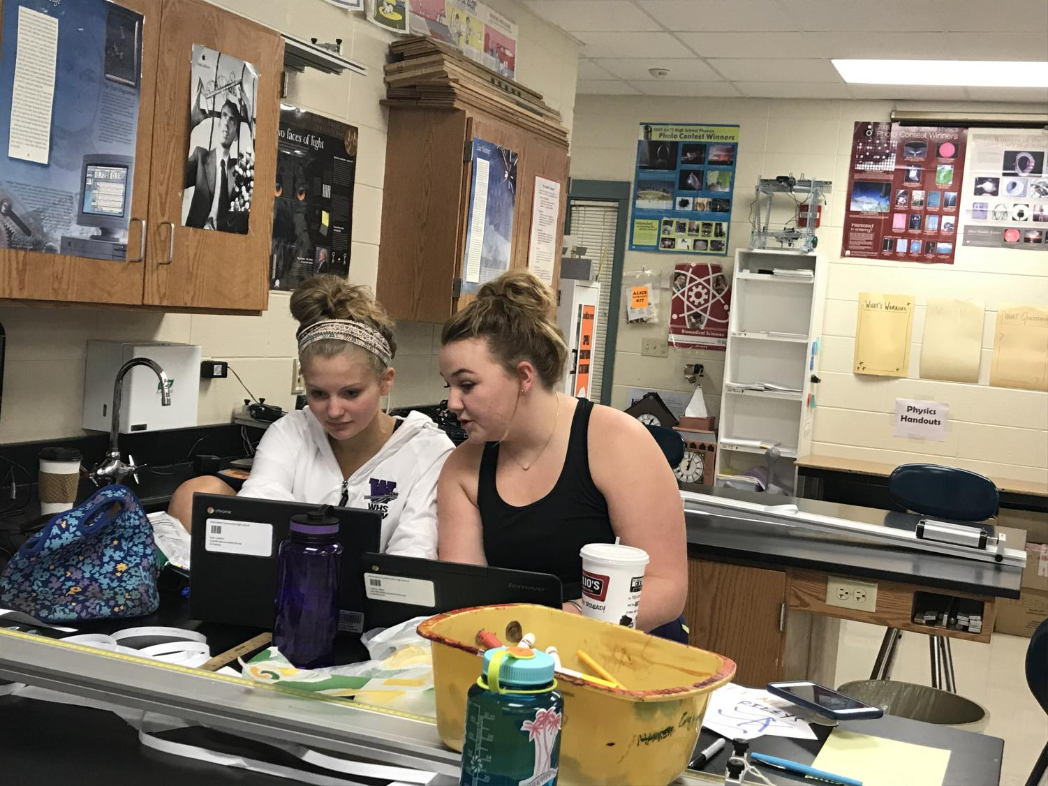 Junior Greta Harris and senior Chloe Fullenkamp work at a Chromebook together. Every student in the school has received their own Chromebook with which they can complete schoolwork, access email, and browse the Internet.